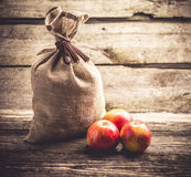 Sack and apples Stock Images