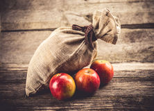 Sack and apples Royalty Free Stock Photos