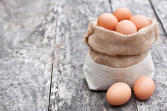 Sack bag with eggs on the old table Stock Images