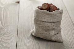 Sack bag full of hazelnuts Royalty Free Stock Photo