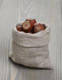 Sack bag full of hazelnuts Stock Photos