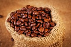 Sack bag full of roasted coffee beans Royalty Free Stock Photos