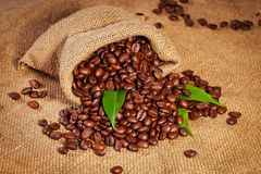 Sack bag full of roasted coffee beans Stock Photo