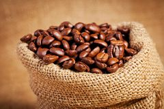 Sack bag full of roasted coffee beans Stock Image