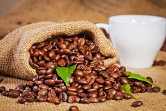 Sack bag full of roasted coffee beans Stock Photography