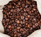 Sack bag full of roated coffee beans Royalty Free Stock Images