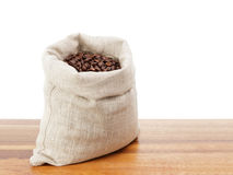 Sack bag full of roated coffee beans Royalty Free Stock Image