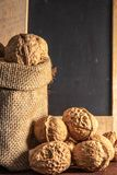 Sack bag with walnut on brown background stock photography