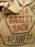 Sack of Barley. Tight crop of a sack of barley, black and red print on the fabric Stock Photo
