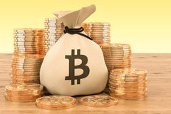 Sack with bitcoin symbol and golden coins around on the wooden t. Able, 3D Royalty Free Stock Photo