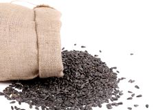 Sack with black sunflower seeds. Royalty Free Stock Images