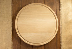 Sack burlap and cutting board on wood Royalty Free Stock Image