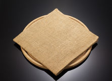 Sack burlap napkin at cutting board Stock Images