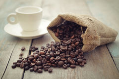 Sack of coffee beans with cup Royalty Free Stock Image