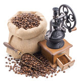 Sack of coffee beans with retro grinder isolated on white Stock Photos