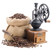 Sack of coffee beans with retro grinder isolated on white Stock Photography