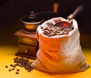 Sack of coffee beans and scoop. Royalty Free Stock Photography