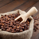 Sack with coffee beans and wooden scoop Stock Photography