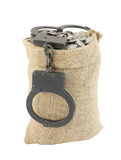 Sack with coins and handcuffs isolated Royalty Free Stock Photo