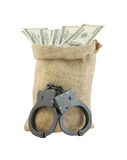 Sack with dollars and handcuffs Stock Photos
