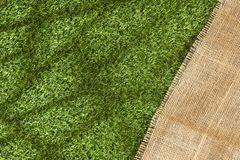 Sack fabric on grass background - Text space. Sack fabric on grass background royalty free stock image