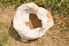 Sack of fish feed pellets Stock Photos