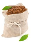 Sack of flax seeds with leaves Stock Photography