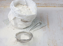 Sack with flour and sieve Stock Photography