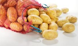 Sack of fresh potatoes. On white background. Horizontal Stock Photography