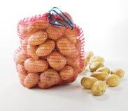 Sack of fresh potatoes. Sack of fresh potatoes on white background Stock Photos