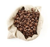 Sack full of coffee beans on white view from above Royalty Free Stock Photos