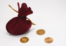 Sack and gold coins. On the white background royalty free stock image