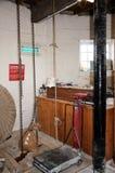 Sack hoist chain and scales inside windmill. Sack hoist chain and weighing scales inside Greens windmill, Nottingham, Nottinghamshire, England, UK, Western stock photography