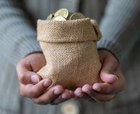 Sack Of Indian Coins in Hand royalty free stock photos