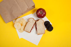 Sack lunch with peanut butter sandwich Royalty Free Stock Photography