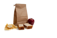 A Sack lunch with peanut butter sandwich Royalty Free Stock Photos