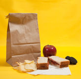 Sack lunch with peanut butter sandwich. A sack lunch with peanut butter sandwich with apple, chips and cookies Stock Images