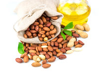 Sack with peanut and glass bottle of oil with leaves Royalty Free Stock Images