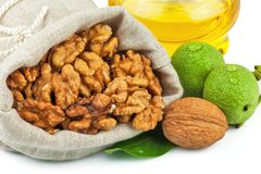 Sack of purified walnut and glass bottle of oil Royalty Free Stock Photo