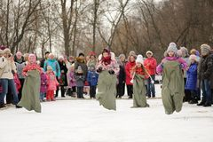 Sack-race during winter Maslenitsa carnival in Russia Royalty Free Stock Images
