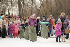 Sack-race during winter Maslenitsa carnival in Russia Royalty Free Stock Photos