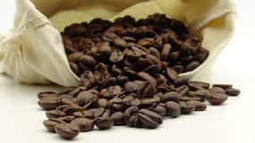 A sack with roasted coffee beans on white background royalty free stock photos