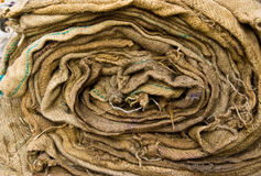 Sack roll. Dirty sack roll with threads Royalty Free Stock Photo