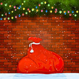 Sack of Santa on a brick wall Royalty Free Stock Photography