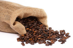 Sack with scattered coffee beans Stock Photos
