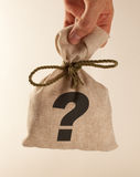 Sack with something. Sack with unknown content in hand royalty free stock image