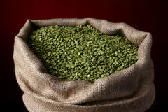 Sack of split green peas Stock Photos