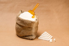 Sack with sugar and plastic scoop Royalty Free Stock Photography