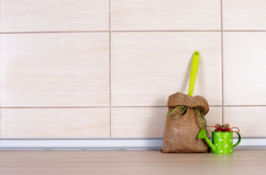 Sack and water pot on kitchen countertop Stock Photos