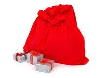 Sack Weihnachtsmann und Geschenke Stockfotos